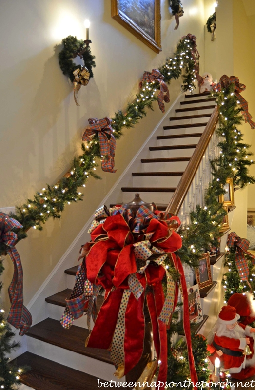 Stairway-Decorated-with-Lit-Garland-and-Ribbon-for-Christmas
