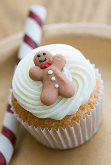 Mini cupcake decorated with a tiny gingerbread man