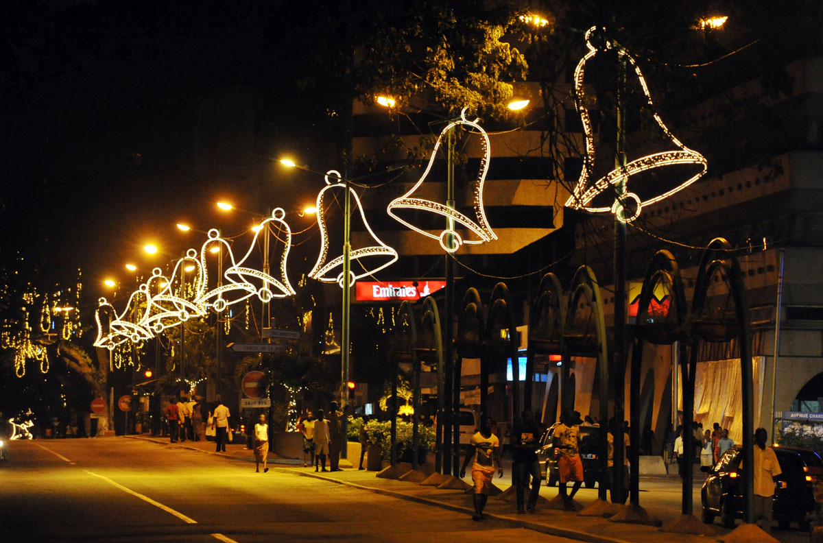 "Christmas lights light the streets of Abidjan on December 15, 2012 after the launch of the 2nd edition of ""Abidjan Perle des Lumieres"" (Abidjan perle of lights) for Christmas and New Year celebrations. AFP PHOTO/ SIA KAMBOUSIA KAMBOU/AFP/Getty Images ORG XMIT: 568"