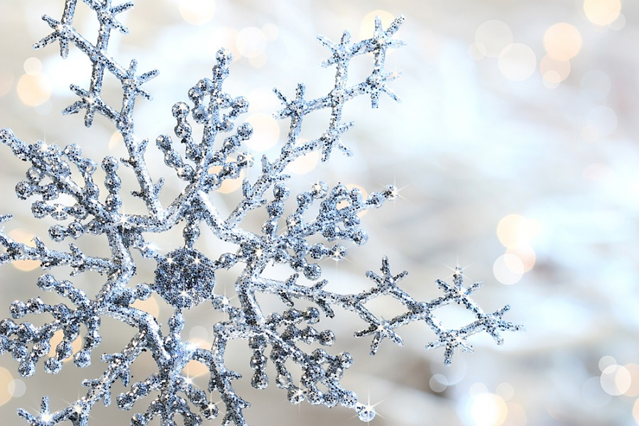 Silver blue snowflake against a shimmering background against a shimmering background